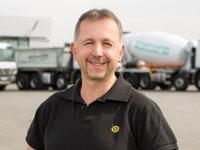 Das Porträtbild von Markus Fabel, Leiter der Werkstatt von ETC Miettrucks.